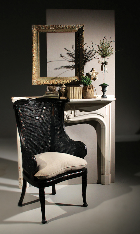 Black Chair in Front of Mantel
